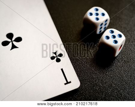 cross ace and two dice on the blackbackground
