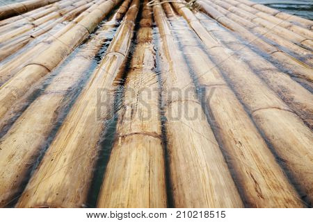sturdy bamboo wood, a raft made of bamboo, background,bamboo floating on the water over the dam.