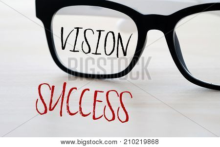 Vision and success and eyeglasses business concept