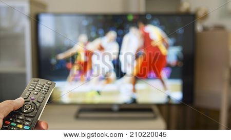 Watch basketball on TV with remote control