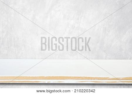 Empty white wooden table over grunge cement wall vintage background template product display montage