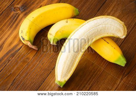 Close up banana on wooden table Healthy concept.