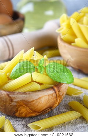 Penne Rigate. Macaroni In The Form Of Feathers. Mostaccioli Pasta