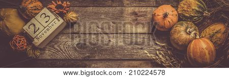 Thanksgiving concept - decorations and pumpkins on kitchen background