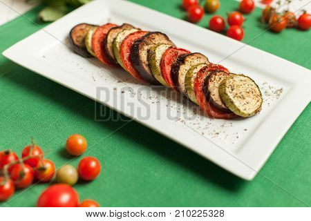 Fresh Ratatouille On Plate With Tomato Decoration On Table