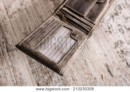 Closeup of an empty brown leather wallet on the table.