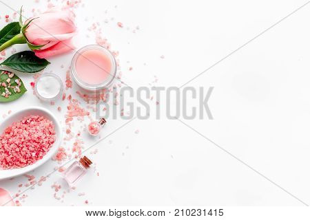 Natural cosmetic with rose oil on white background top view.