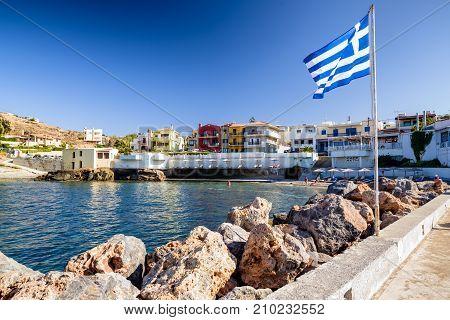 PANORMOS CRETE - SEPTEMBER 16: Waving greek flag in resort Panormos on September 16 2017in Panormos