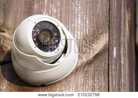 The CCTV security camera operating outdoor on the street