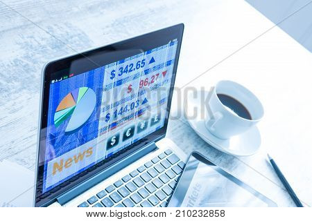 Stock market trading and research software on a Tablet PC with a Laptop computer.