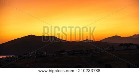 Sunrise at Crete island. Colorful yellow sky and silhouette