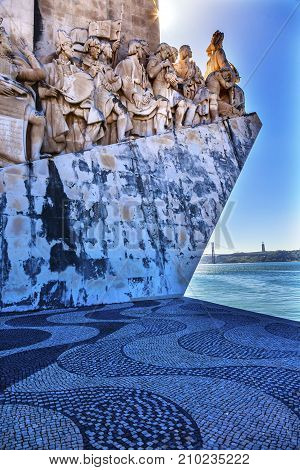 LISBON, PORTUGAL - MAY 12, 2014 Monument to Diiscoveries Explorers Padrao dos Descobrimentos Tagus River Belem Lisbon Portugal. The monument was conceived by Portuguese Continellis and Sculptor Almeida in 1939. Based on the plans the Portuguese government
