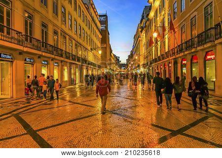 LISBON, PORTUGAL - SEEPTEMBER 11, 2017 Rua Augusta Street Evening Walking Shopping Street Black White Tiles Shops Restaurants Baixa Lisbon Portugal. Rue Augusta is main walking street in Lisbon.
