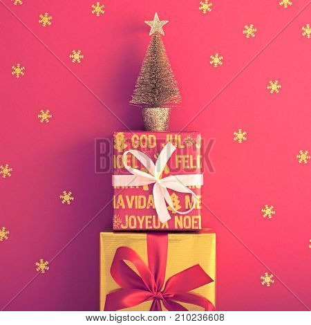 Christmas background decoration Handmade, Christmas holiday Gold Gift boxes, Snowflakes, Fir. New Year, Happy XMAS Design Ornament. Festive Art Colorful Greeting Card. Retro Vintage on Red