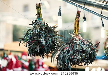 Christmas decorations on the market. Christmas mistletoe plant bunch as Christmas symbol hanging on market in Europe. Omela