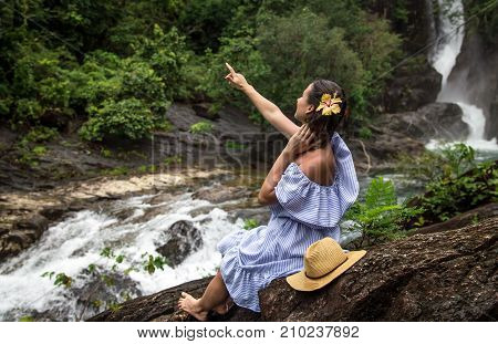Girl Looks At The Waterfall