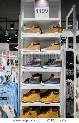 Boots - A lot of winter boots on the shelf in the store.
