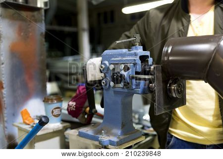 Experienced operator. Metalworking industry concept professional engineer metalworker operating milling machine center in tool manufacturing workshop