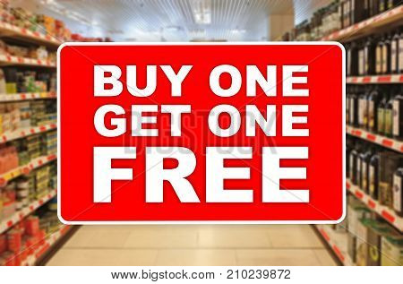 Buy One Get One Free Red Label On An Abstract Supermarket Background