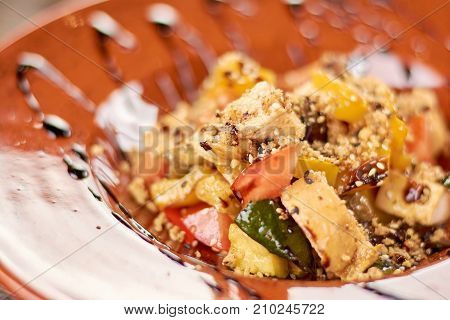 Delicious salad with vegetables and chicken. Fresh salad with grilled vegetables and roasted chicken close up. Tasty dinner in restaurant.
