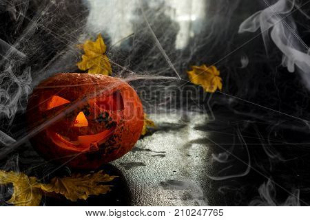 Halloween pumpkin head with spiderweb. Scary evil face spooky holiday. Helloween part. Helloween attributes.