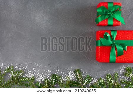 Red christmas gift boxes with ribbons. New year, winter holydays concept. Top view, copy space