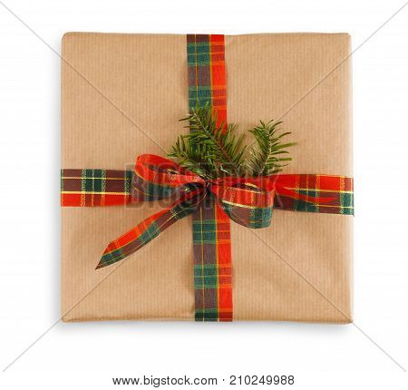 Gift box wrapped in craft brown paper and checkered ribbon, isolated on white background. Modern present for any holiday, christmas, valentine or birthday