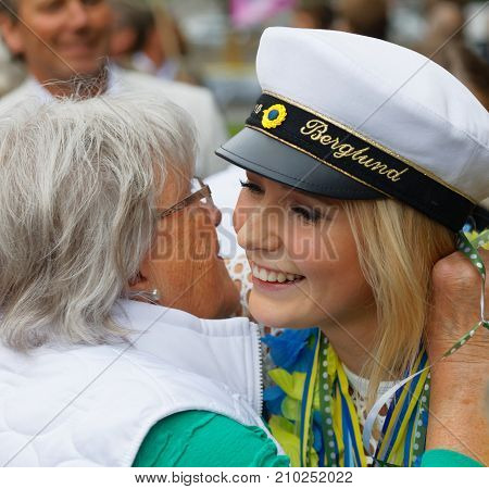 STOCKHOLM SWEDEN - JUN 13 2017: Proud grandmother hugging her graduating daughter at the dance school Balettakademien June 13 2017StockholmSweden
