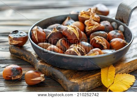 Roast Chestnuts In A Pan Closeup.