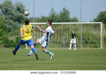KAPOSVAR, HUNGARY - JUNE 11: Tamas Nagy (in yellow) in action at the Hungarian National Championship under 13 game between Kaposvari Rakoczi FC and Bajai LSE on June 11, 2011 in Kaposvar, Hungary.