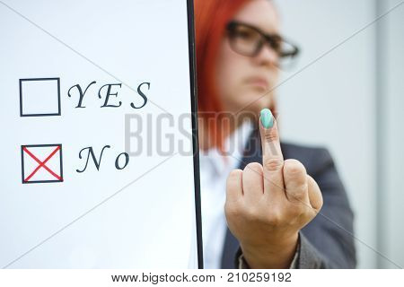 Business Concept Of Choice And Voting. A Woman In A Suit And Glasses Makes A Choice - No, And Shows