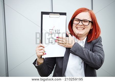 Business Concept Of Choice And Voting. A Woman In A Suit And Glasses Makes A Choice - Yes. With A Pl