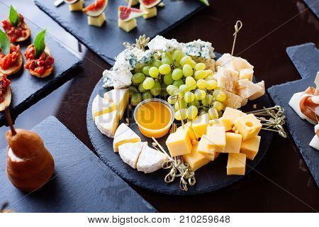 Cheese Plate: Emmental, Camembert Cheese, Blue Cheese With Grapes