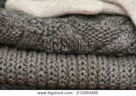 Knitted details of warm clothes sweater and gloves