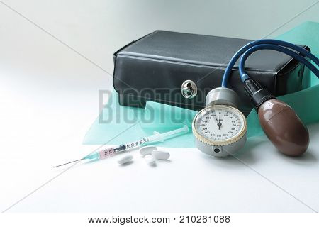 Various medical tools for a pediatrician on a glossy background