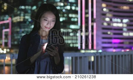 Young Woman use of smart phone at night