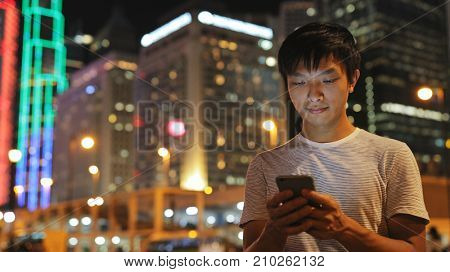 Man using smart phone in the city