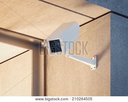 White security camera at the entrance of the building. 3d rendering