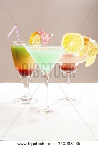 Tropical fruit cocktail concept. Cocktail with umbrella colorful illustration on isolated white studio background. Sexy delicious fashion drinks. Alcohol cocktails.