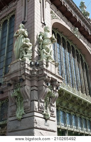 Saint-Petersburg Russia - May 28 2017: Sculpture on the facade of the Comedy Theater. N.Akimova. The former building of the Eliseev brothers' shop in St. Petersburg Russia
