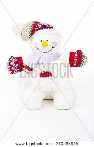 Snowman. Plush soft toy snowman on isolated white studio background. Winter decoration.