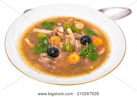 Vegetable soup with meat and olives. Studio Photo