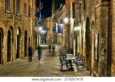 Street view of San Gimignano in Tuscany Italy by night. UNESCO World Heritage Site