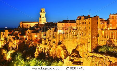 City Of Pitigliano In Tuscany, Italy After Sunset