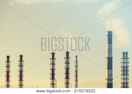 Chimney of the old factory. Environmental pollution