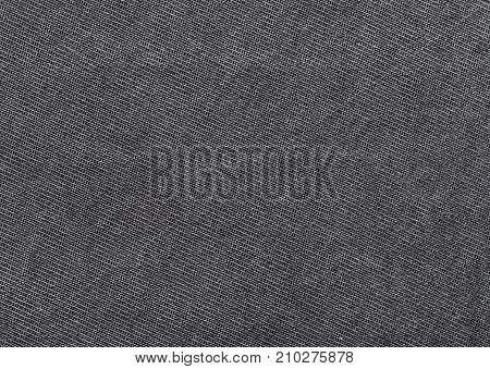 Close up shot of black worn denim jeans fabric background macro