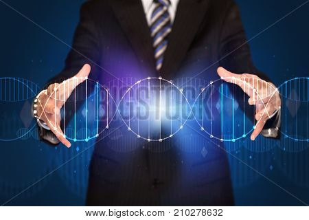 Businessman with DNA concept in his hands