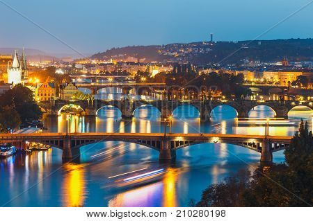 View Of  Bridges With Historic Charles Bridge And Vltava River At Night In Prague, Czech Republic