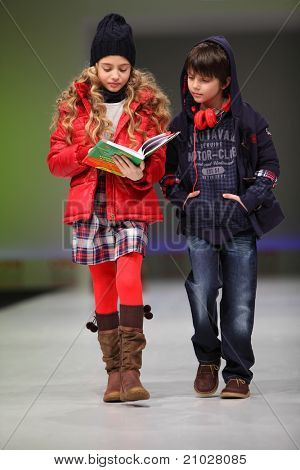 MOSCOW - FEBRUARY 22: Unidentified child models wear fashions from Snowimage and walk the catwalk in Collection Premiere Moscow, an international fashion fair for Eastern Europe, on February 22, 2011 in Moscow, Russia