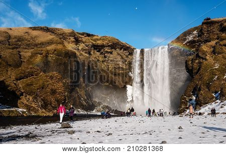 ICELAND - 2 MAR - Tourist traveling in holiday at Skogafoss waterfall, popular landmark in Iceland at winter time on March 02, 2017 at Iceland